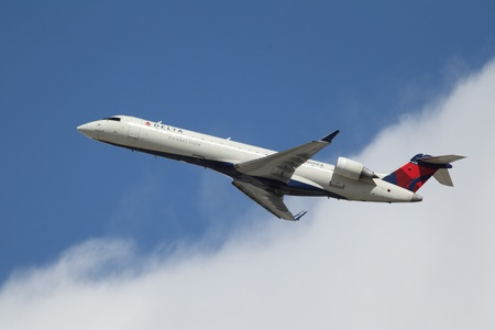 bombardier: LOS ANGELES, CALIFORNIA, USA - MARCH 8, 2013 - Delta Connection Bombardier CRJ-701 takes off from Los Angeles Airport on March 8, 2013. The plane has a range of 2,656 km with 66 seats.