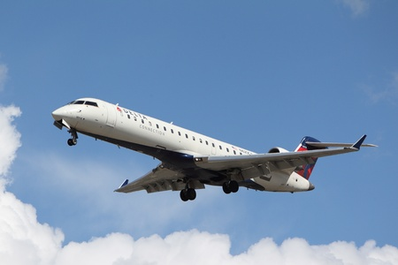 bombardier: LOS ANGELES, CALIFORNIA, USA - MARCH 8, 2013 - Delta Connection Bombardier CRJ-701 lands at Los Angeles Airport on March 8, 2013. The plane has a range of 2,656 km with 66 seats.