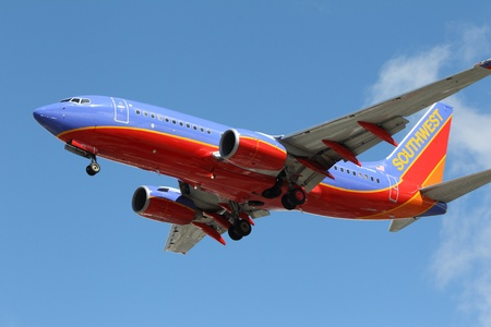 LOS ANGELES, CALIFORNIA, USA - MARCH 8, 2013.   Southwest Airlines Boeing 737-7H4 lands at Los Angeles Airport on March 8, 2013 in Los Angeles, CA. The plane has a range of 6,340 miles with 177 seats.