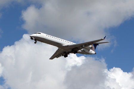 bombardier: LOS ANGELES, CALIFORNIA, USA - MARCH 8, 2013 - United Express Bombardier CRJ-701 takes off from Los Angeles Airport on March 8, 2013. The plane has a range of 2,656 km with 66 seats.