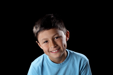 Smiling boy on black background with dramatic side lighting Stock Photo