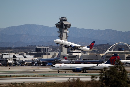 california delta: LOS ANGELES, CALIFORNIA, USA - April 17, 2013 - Delta Air Lines Boeing 737-832 takes off from Los Angeles Airport on April 17, 2013. The plane has a range of 5,765 km and a maximum speed of 544 mph
