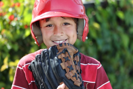 Young baseball boy with red helmet Stock Photo