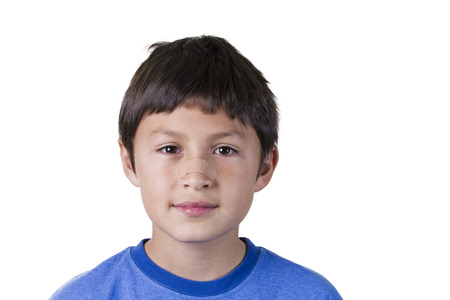 Young boy with plaster on his nose  Stock Photo