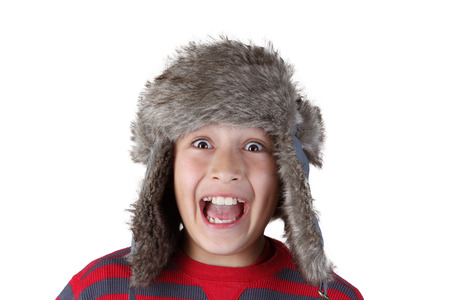 Young boy pulling funny face photo
