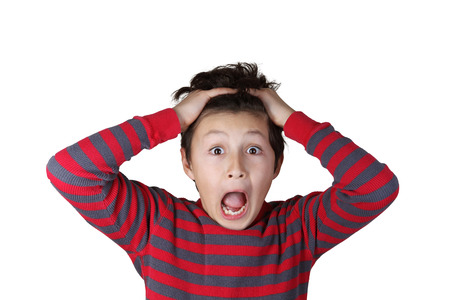 startled: Young boy with shocked expression on white isolated background