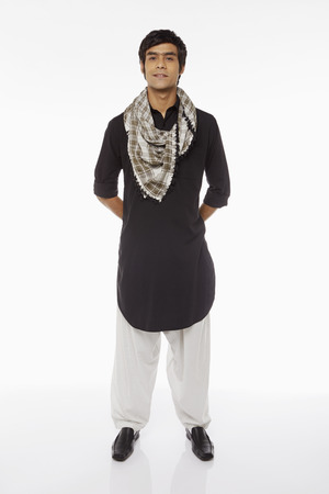 kameez: Man in traditional clothing standing and smiling Stock Photo