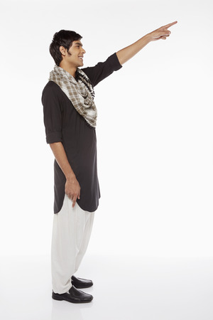 kameez: Man in traditional clothing pointing towards the left Stock Photo