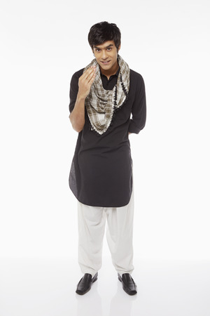 kameez: Man in traditional clothing showing an Islamic greeting gesture Stock Photo