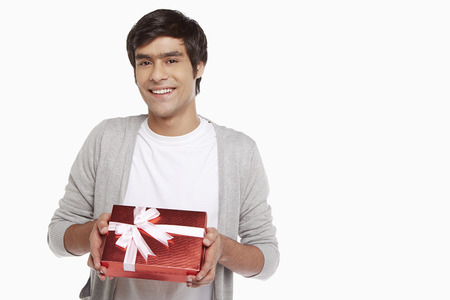 red gift box: Man holding a red gift box