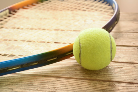 competitive sport: tennis ball on wooden table Stock Photo