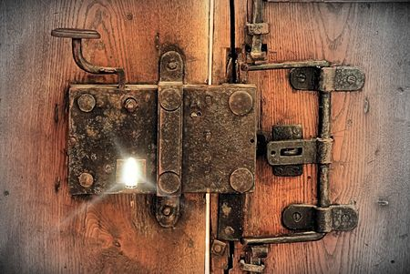 ancient tradition: very old locker on medieval Cathedral main door Stock Photo