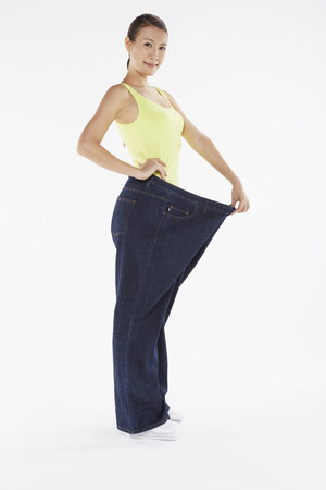 over sized: Woman in over sized jeans