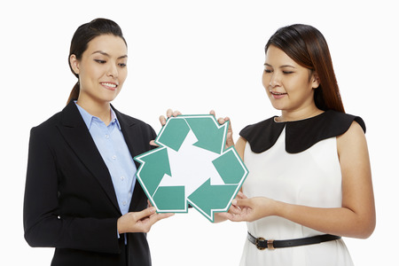recycle logo: Two women holding up a Recycle logo
