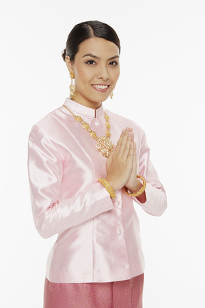 courteous: Woman in traditional clothing showing hand greeting gesture Stock Photo