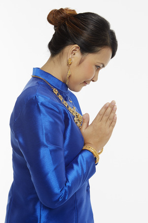 bowing head: Woman in traditional clothing bowing her head