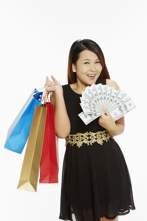 Woman with a lot of money carrying paper bags photo