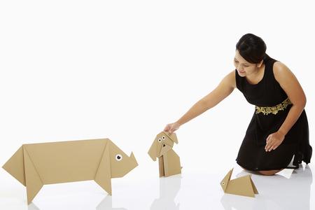 petting: Woman petting a paper dog