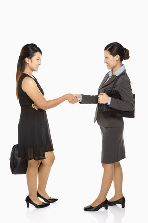 Two businesswomen shaking hands photo