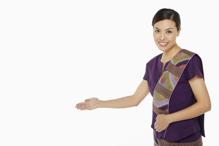 courteous: Woman in traditional clothing showing greeting gesture Stock Photo