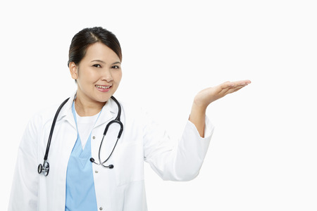 medical personnel: Cheerful medical personnel showing hand gesture Stock Photo