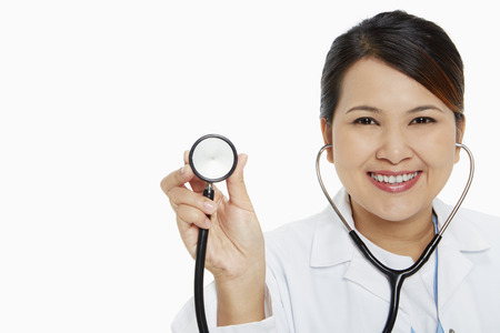 medical personnel: Medical personnel holding up a stethoscope