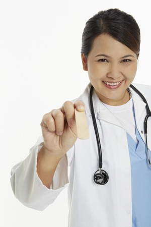 medical personnel: Medical personnel holding a tongue depressor Stock Photo