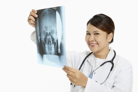 medical personnel: Medical personnel examining an x-ray film