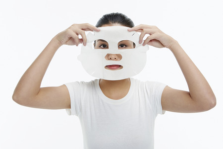 Woman applying face mask photo