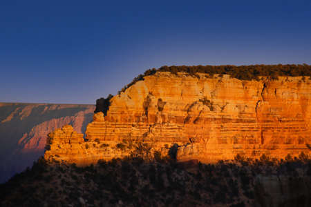 Grand Canyon rock at sunset with a blue sky