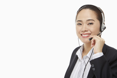 Smiling businesswoman with headset photo