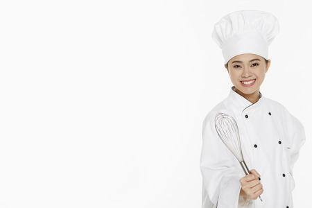 wire whisk: Female chef holding a wire whisk