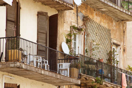 balconies, the old house, in France, the picture up close, wood doors photo