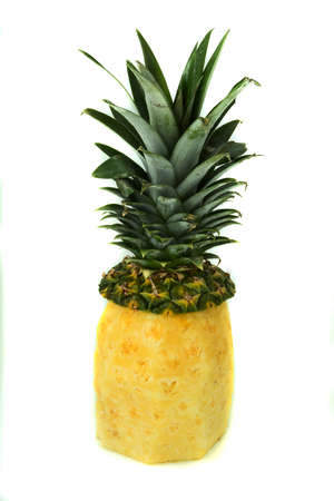 the close range: Pineapple with green leaves, cutting, yellow, top photo at close range on a white background, isolation