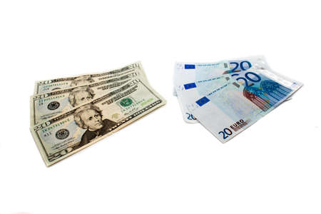 twenty euros and twenty dollars, which have been spread out by a fan