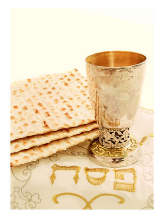 the feast of the passover: the symbols of the feast of the Passover, matzah, the Cup with wine, white cloth with embroidery and font on the Hebrew Pesach, on a white background, isolated