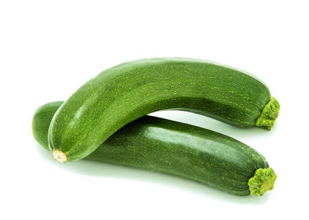 lie: two zucchini, lie next to eachother; white background