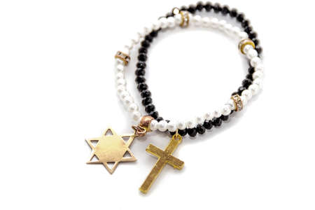 zionism: Two pearl necklaces, one with the cross, another star of david with the star-six-corners, isolated, white background