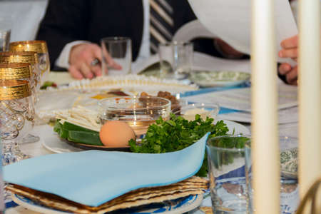 seder table with Passover plate, and special meal with egg, parsley