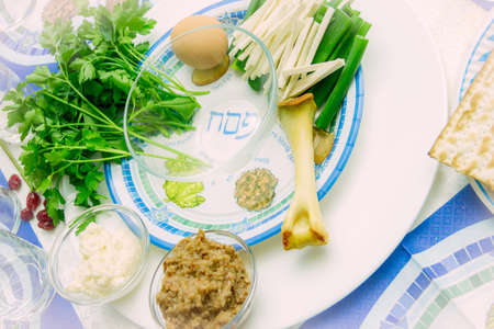 seder: seder plate for passover ceremony with symbols, parsley, egg and matzoh Stock Photo