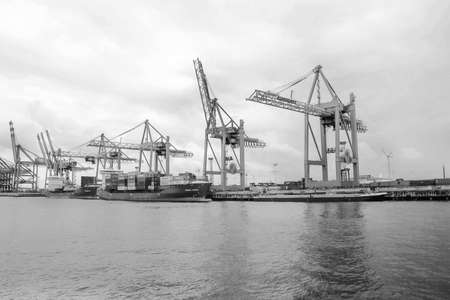 located: cranes and ships located on the horizon against the sky, harbor, Hamburg, ships, The Second Largest City in Germany Stock Photo