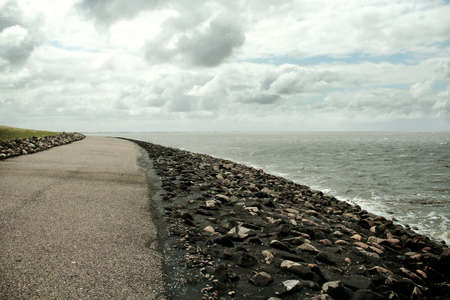 Horizon by the Sea, blue sky, clouds, asphalt, road, rocks, green grass, Tides photo