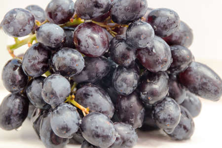 Grapes blue close up; kernels; sweet;