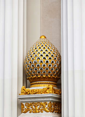 an architectural element of decoration of a historic building made of marble covered with gold