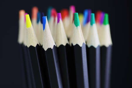 Color pencils close up on black background
