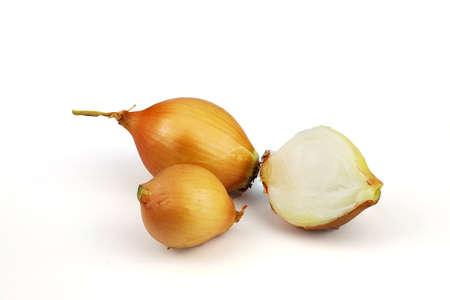 Cut fresh bulbs of onion on a white background