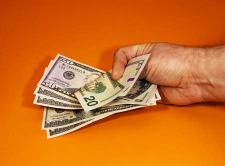 Hand with money, Hand holding Banknotes, Orange background