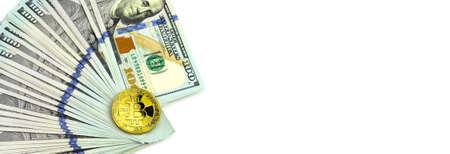 US dollars lie in a fan and a bitcoin coin. Concept for barner, site header.