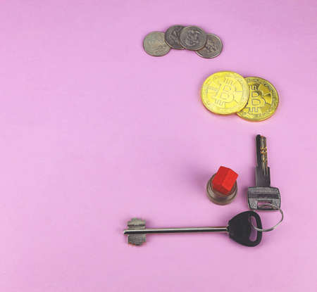 House keys, paper American dollars, coins on a white background. Selective focus. Concept for sale, rent, house purchase, investment, mortgage.
