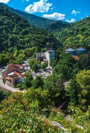 Asenovgrad, Plovdiv  Bulgaria – 08112018: flour mill Nikola Panayotov among the mountains covered with green vegetation for your design 新聞圖片